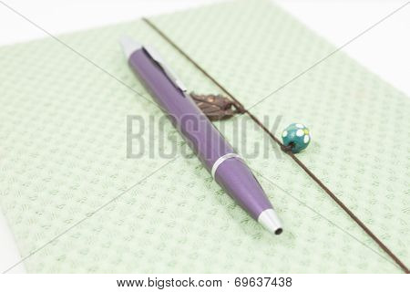 Closeup Handmade Notebook With Pen Isolated On White Background