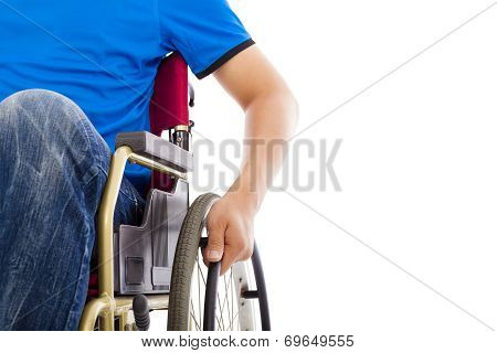 closeup of mans hand on the wheel on a wheelchair