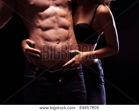 Woman Craving Very Sexy Male Six Pack Abs. Isolated on Black Background