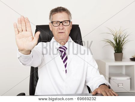 Serious Doctor Showing Hand Stop Sign