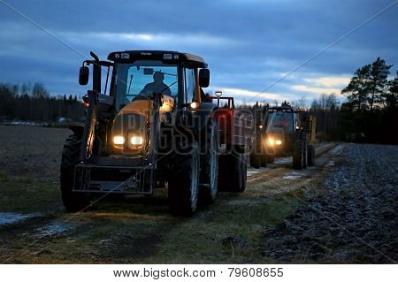 Two Agricultural Tractors On A Winter Night