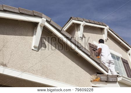 Busy House Painter Painting the Trim And Shutters of A Home. poster
