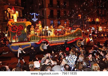 BARCELONA, SPAIN - JANUARY 5: The Cavalcade of Magi on January 5, 2015 in Barcelona, Spain. The Magi and their servants parade in floats by the main streets of the city