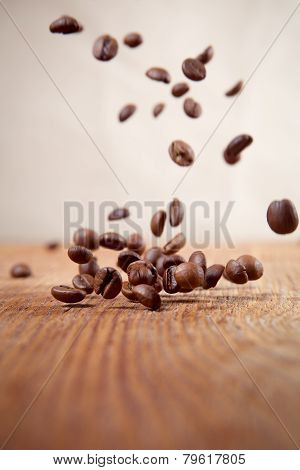 Flying Coffee Beans On A Abstract Background
