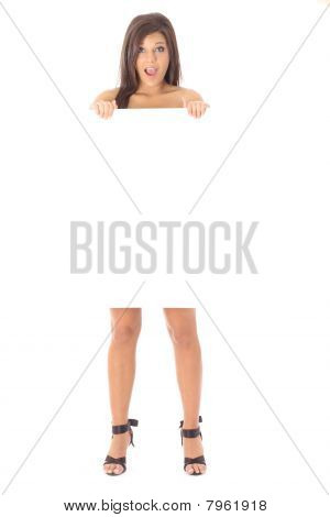 naked brunette holding a blank sign