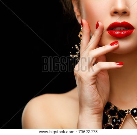 Red Sexy Lips and Nails closeup. Open Mouth. Manicure and Makeup. Make up concept. Half of Beauty model girl's face isolated on black background poster
