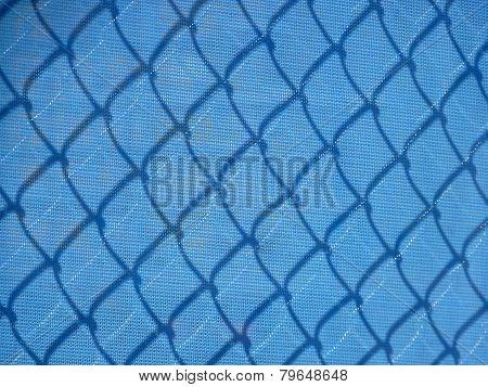 Blue mesh construction fence