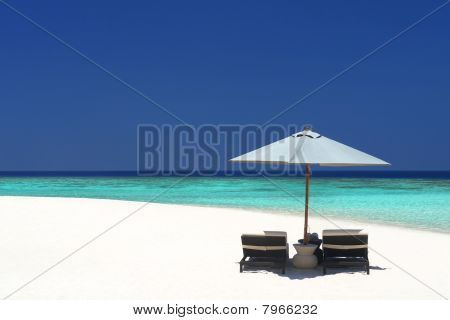 Beach Chairs On An Island Paradise
