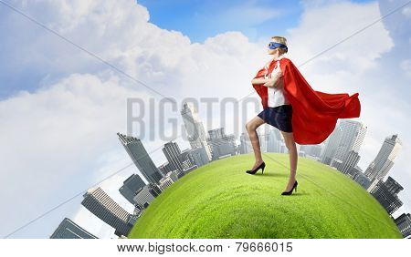 Young confident woman in super hero costume