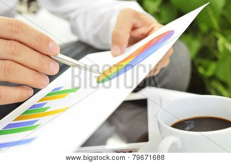 closeup of a young businessman checking some charts