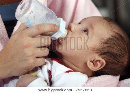 Mother feeding her baby boy