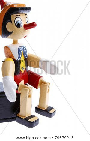 Wooden pinocchio on plain background