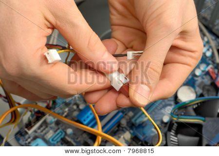 Technician's Hands At Work