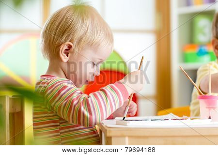 kid painting at home or nursery