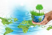Hands holding globe. Environmental energy concept of global business from concepts series. poster