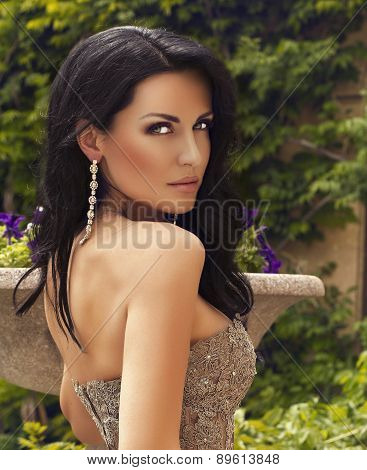Sensual Woman With Dark Hair Wearing Luxurious Sequin Dress