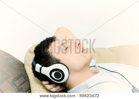 Handsome Guy Listening To Music On Headset With Eyes Closed