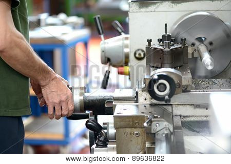 Blue-collar Worker Doing Manual Labor With A Lathe