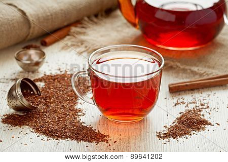 Healthy rooibus tea traditional south africa antioxidant beverage with spices on vintage wooden table in rustic style poster