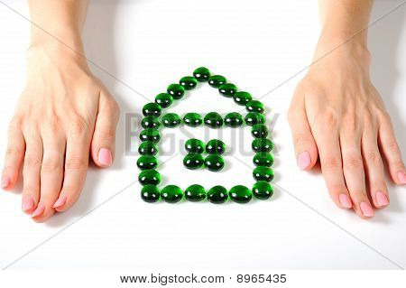 Beautiful Womans Hands And Real Estate Icon Made Of Little Stones