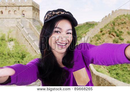 Girl Taking Photo At Great Wall Of China