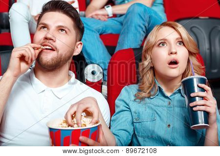 Interested couple in cinema