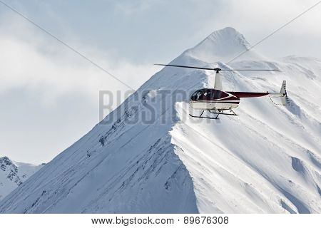 Helicopter flying in the mountains on the Kamchatka Peninsula. Far East Russia