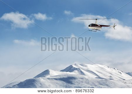 Helicopter flying over the mountains on the Kamchatka. Russia, Far East