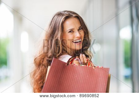 Close-up, Over-the-shoulder Smiling Brown-haired Woman Shopping