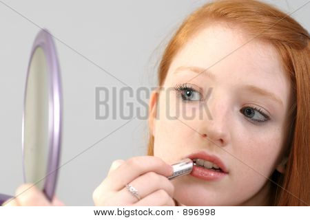 Applying Lipstick With Hand Mirror