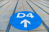 blue arrow on pavement slabs, symbol of orientation, clarity and information poster