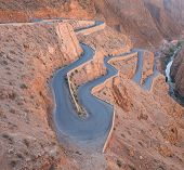 The zigzag road to Gorges du Dades valley during end of winter and beginning of spring on March 2014 in Gorges du Dades or Dadиs Gorges city which located in Morocco poster