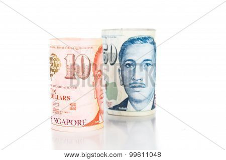 Close Up Of Rolled Up Singapore Dollar Currency Note