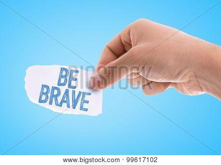 Piece of paper with the word Be Brave with blue background poster
