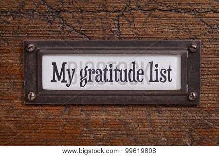 My gratitude list - a label on a grunge wooden file cabinet