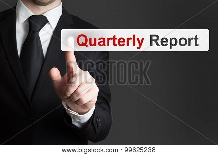 Businessman Pushing Button Quarterly Report