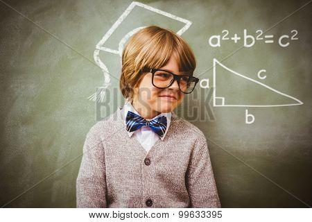 Trigonometry against boy smiling in front of blackboard