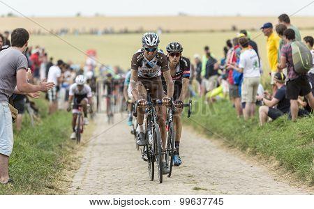 The Peloton On A Cobblestone Road - Tour De France 2015