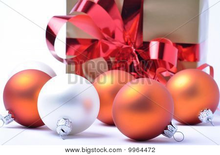 Christmas Baubles And Gift Isolated On White Background