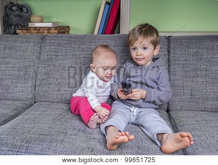 Very Small Children Watching Television