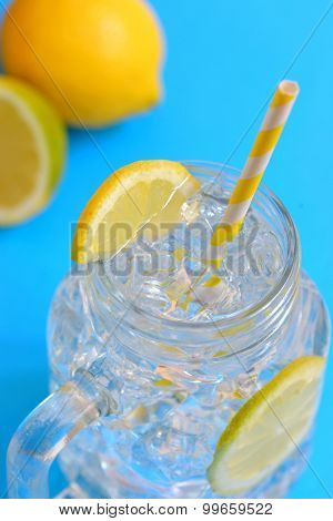 water with lemons and paper straw