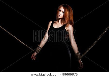 Beautiful Young Woman With Tied Arms