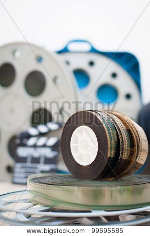 35 Mm Movie Reels With Clapper And Boxes In Background