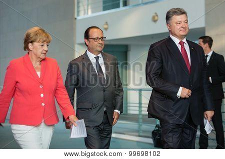 Francois Hollande, Angela Merkel And Petro Poroshenko
