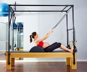 pregnant woman pilates reformer roll up cadillac exercise workout at gym poster
