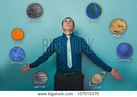 businessman man looks up and stretched out his hands to the side
