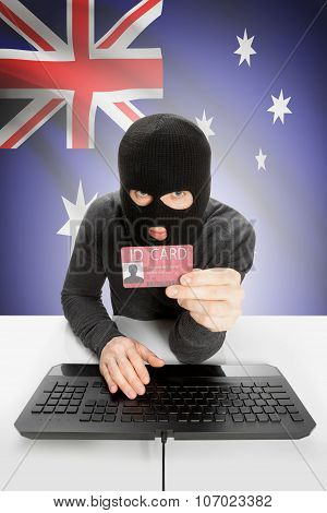 Hacker With Flag On Background Holding Id Card In Hand - Australia