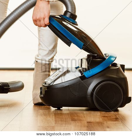 poster of Young woman opening vacuum cleaner on white. Houseworking in home.
