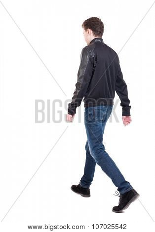 Back view of going  handsome man in jacket.  walking young guy . Rear view people collection.  backside view of person.  Isolated over white background. The guy in the demi-season jacket leaves poster