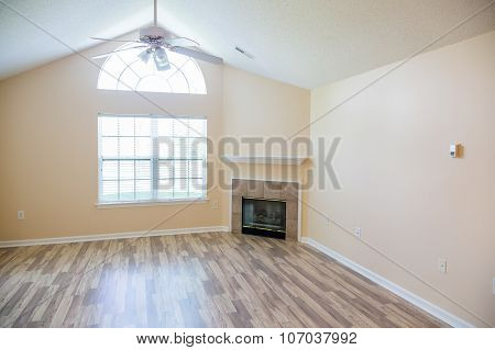 Shiny New Hardwood Floor With Fireplace In Corner